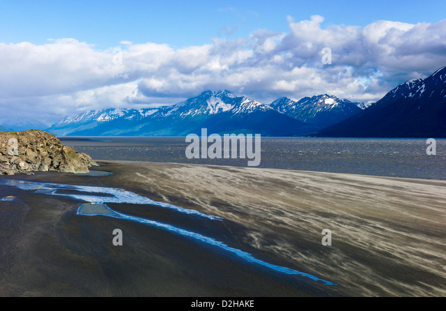 Fierce winds rip across a rugged landscape of sea and mountains, Turnagain Arm, south of Anchorage, Alaska, USA - Stock Image