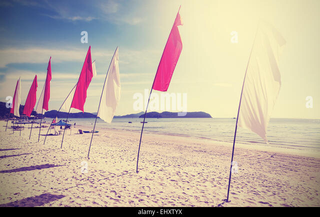 Retro filtered picture of flags on a beach. Concept for summer and freedom. - Stock-Bilder