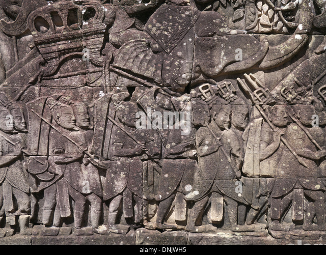 Cambodia Angkor Thom part of Angkor Wat temple complex.   Bas relief of everyday life in 12th century - Stock-Bilder