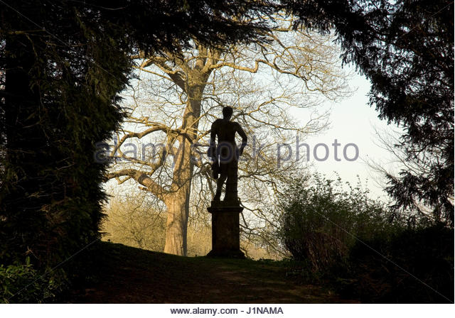 SILHOUETTE OF CLASSICAL STATUE OF YOUNG MAN AT ROUSHAM  OXFORDSHIRE - Stock Image