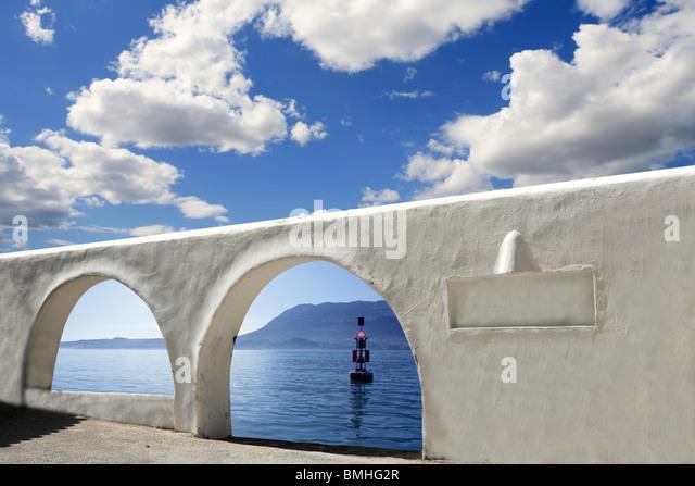 mediterranean sea view white archs architecture blue sky - Stock Image