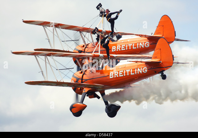 Breitling Wingwalkers British aerobatics and wingwalking team performing at Farnborough Airshow 2012, UK - Stock Image