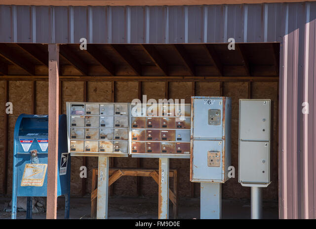 Old Rural Mobile Locked Mail Boxes and U.S. Postage Box Historic Hill City  Idaho, USA - Stock Image