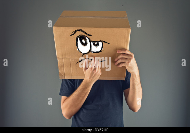Man thinking with cardboard box on his head with serious face expression. - Stock Image