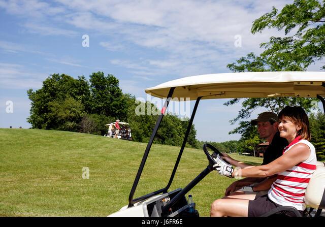 Wisconsin Kenosha Kansasville Brighton Dale Links golf course county park system woman man electric cart fairway - Stock Image