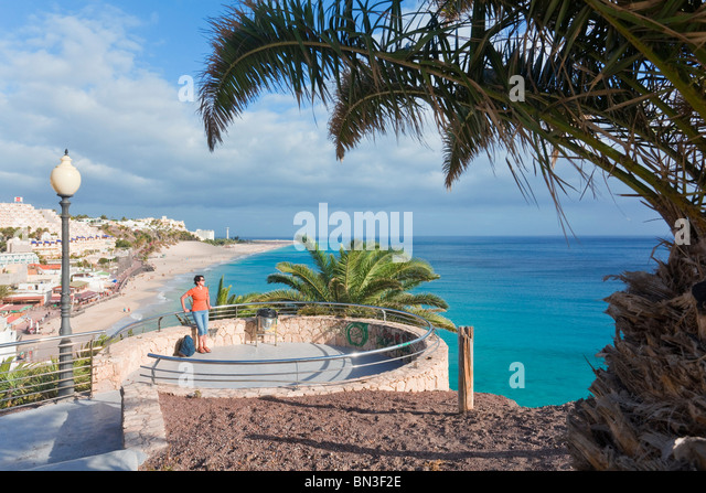 Woman at a lookout point in Morro Jable, Fuerteventura, Spain, elevated view - Stock Image
