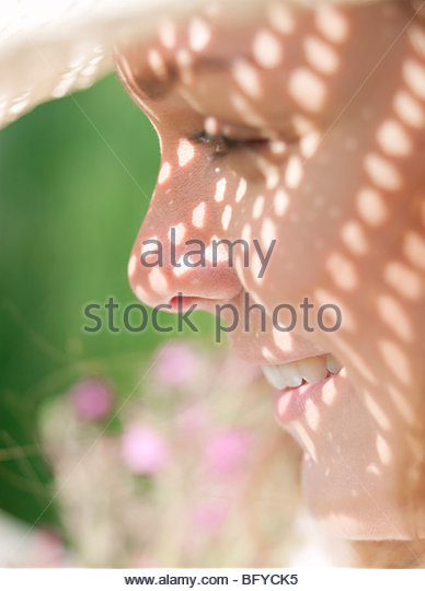 Woman in sun hat in sunshine - Stock Image
