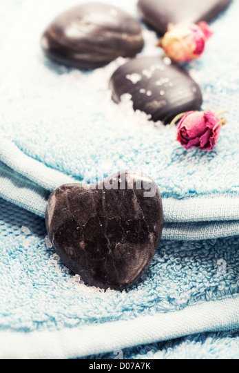 Bath and spa Valentine theme with blue towel - Stock Image