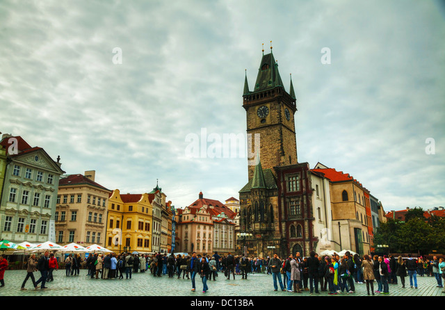 Old Town Square with tourists in Prague. Old Town Square is a historic square in the Old Town. - Stock Image