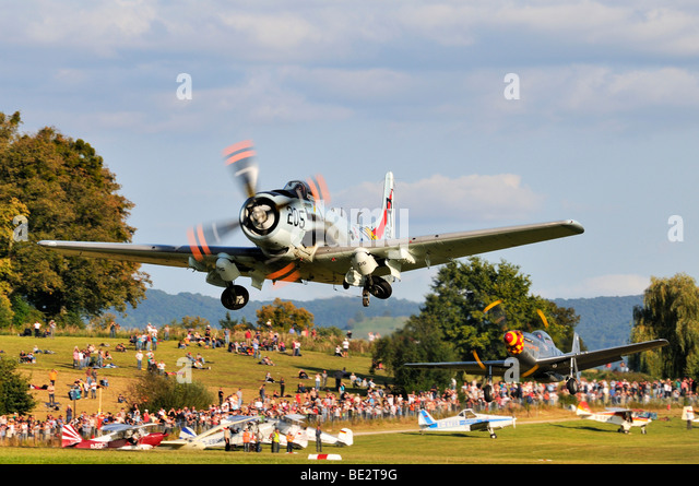 American fighter-bombers Douglas A-1 Skyraider and North American P-51 Mustang immediately after take-off, Europe's - Stock Image