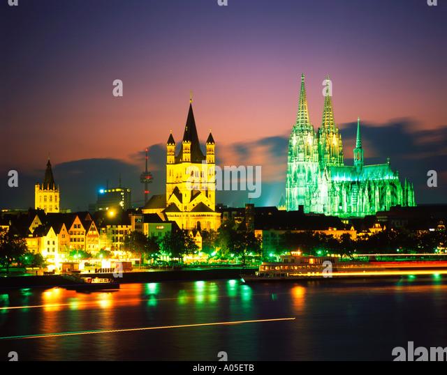 Cologne Koeln Gross St Martin rhine riverside sunset KD fleet ships - Stock Image
