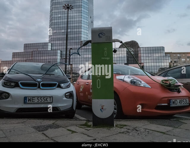 Two cars plugged to charging station, Warsaw, Poland - Stock Image