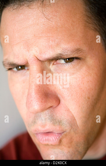 Photo of a serious, good looking man. - Stock Image