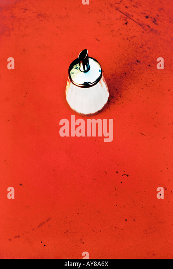 Sugar Shaker On Red Table High Angle View - Stock-Bilder