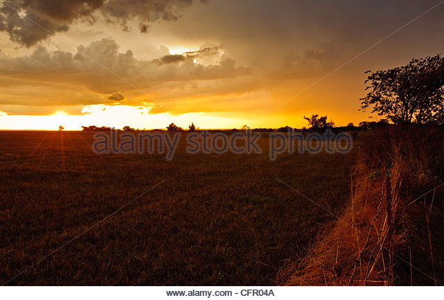 Storm Clouds over Field at Sunset, Flint Hills, Hamilton, KS., Sept. 10, 2011 - Stock Image