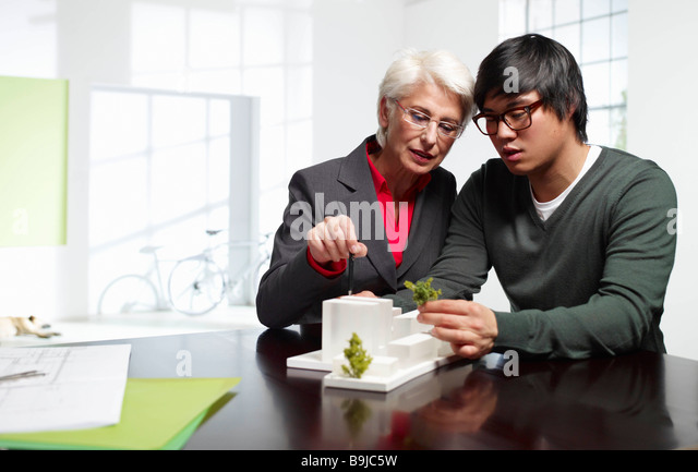 Senior and junior architects at work - Stock Image