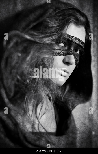 Young woman with mask. Black and white concept with aged effect. - Stock Image