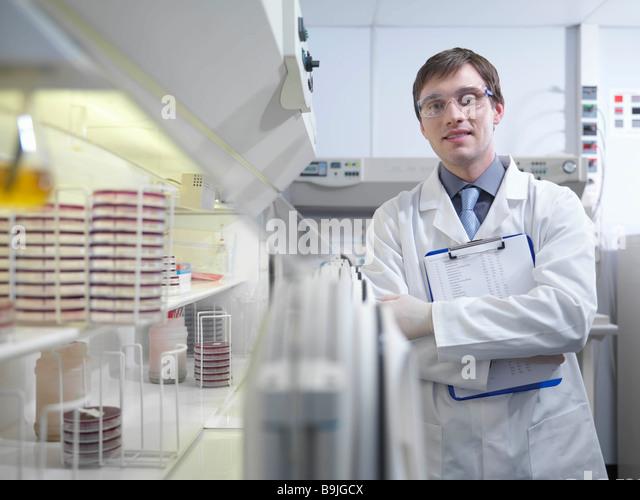 Laboratory technician with clipboard - Stock Image