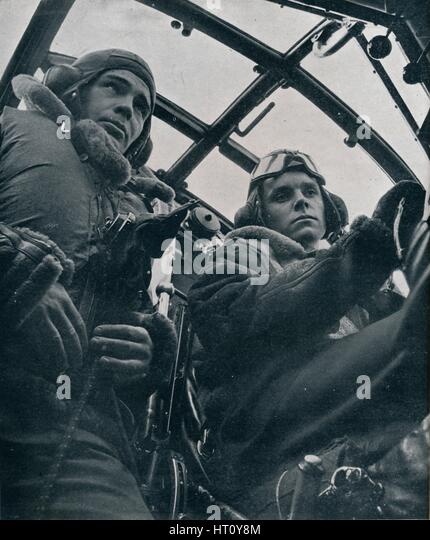 RAF bomber pilot and second pilot, 1941. Artist: Unknown. - Stock Image