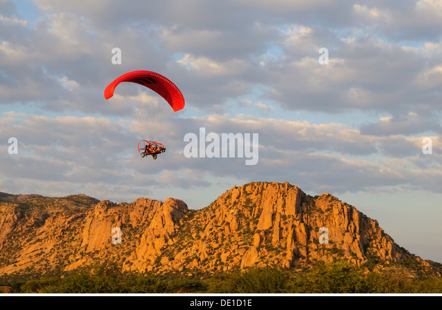 sports paragliding paraglider Xcitor 2009 motor-driven paraglide Erongo Namibia Southern Africa mounts mount flying - Stock Image