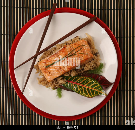 Top View of Healthy Salmon Dinner on Patterned Placemat - Stock Image