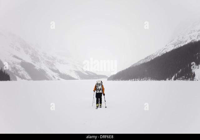 Alberta Canada. skier on frozen lake on Wapta Traverse Canada - Stock Image