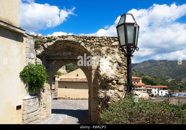 medieval gateway in the ancient village walls of savoca on the island of sicily, italy - Stock Image