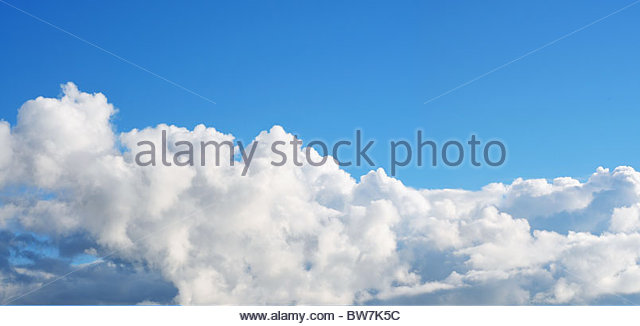Blue sky and puffy cloud - Stock Image