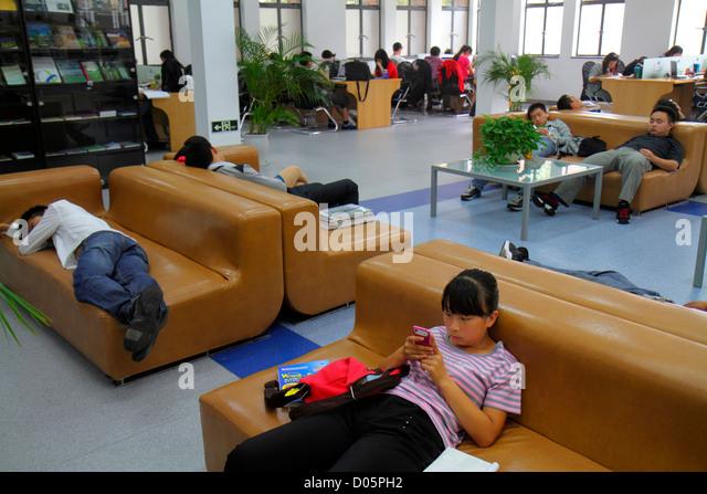 Shanghai China Yangpu District Tongji University Siping Campus student library Asian man woman teen boy girl studying - Stock Image