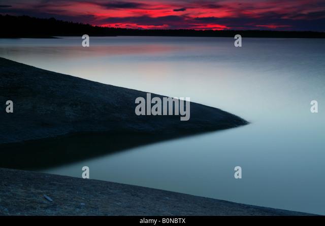 Sundown at the island Østenrødøya in the lake Vansjø, Råde kommune, Østfold fylke, - Stock-Bilder