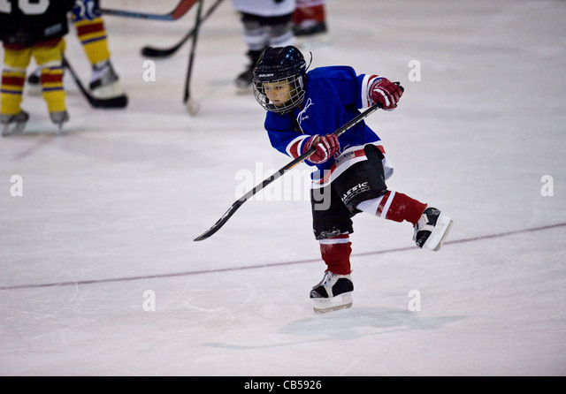 children ice hockey training - Stock Image