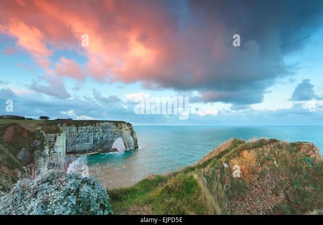 beautiful sunrise on Atlantic ocean coast, Etretat, France - Stock Image