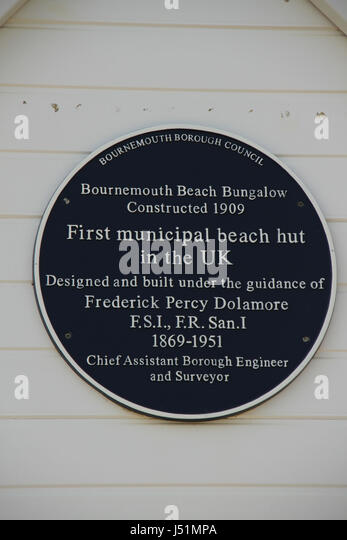 Bournemouth, UK -  11 May: Plaque on a beach hut located in Bournemouth beach. General view of the seaside town - Stock Image