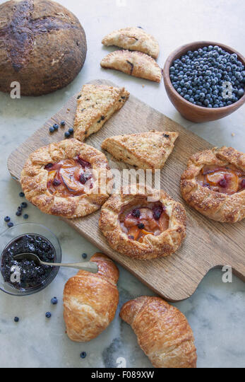 variety of morning fresh baked goods for breakfast - Stock Image