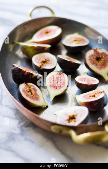 Figs in honey on a baking tray - Stock Image