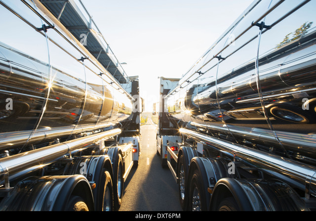 Stainless steel milk tankers side by side - Stock Image