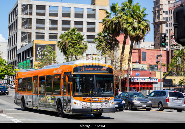 Los Angeles California CA L.A. Downtown South Hill Street street scene traffic LACMTA Metro Bus MTA public transportation - Stock Image