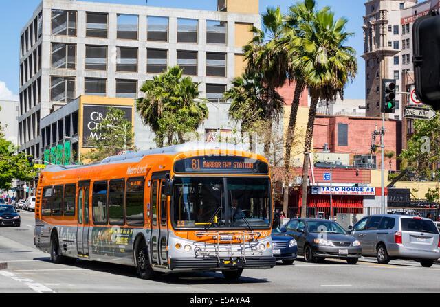Los Angeles California CA L.A. Downtown South Hill Street street scene traffic LACMTA Metro Bus MTA public transportation - Stock Image