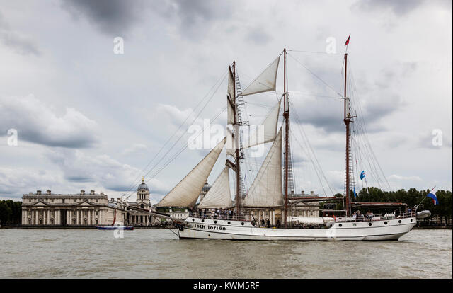 Tall ship J.R. Tolkien passes the Royal Naval College in Greenwich and sails down the River Thames on the first - Stock Image