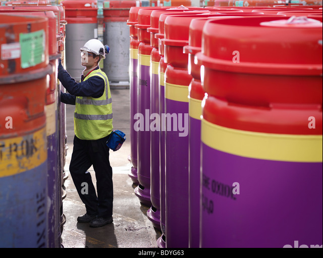 Port Worker Inspecting Containers - Stock Image