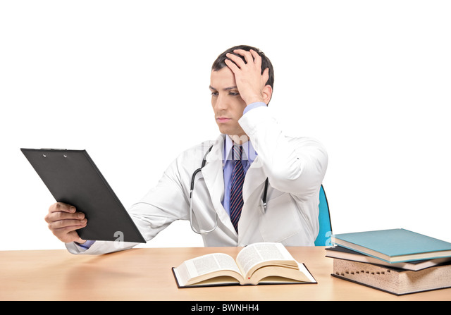 A view of a doctor banging his head realizing a mistake - Stock Image