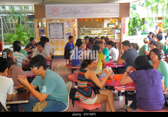 Singapore National University of Singapore NUS school student campus Asian man woman food court cafeteria dining - Stock Image