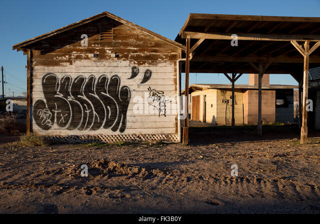 Graffiti on an abandoned house in Bombay Beach on the Salton Sea California - Stock Image