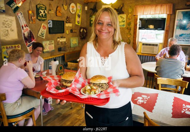 Indiana Chesterton Smokey's Southern Barbecue BBQ woman women restaurant food eat meal pulled pork sandwich - Stock Image
