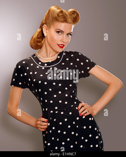 Romance. Styled Woman in Blue Retro Polka Dot Dress. Pin Up Style - Stock Image