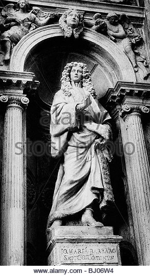 Statue of a member of the Barbaro family on the façade of the church of Santa Maria de Giglio, Venice, Italy - Stock-Bilder