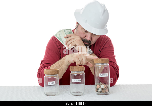 Construction worker wearing a hardhat deciding over the use of money between, taxes, vacations or tuitions - Stock Image