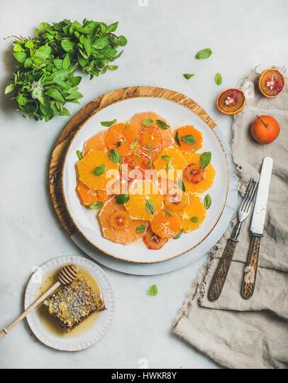 Vegan Fresh mixed citrus fruit salad with mint and honey - Stock Image
