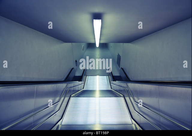 downward view of modern steel subway station stairs - Stock Image