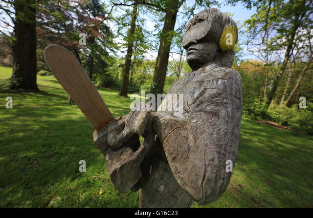 Chain saw carving stock photos